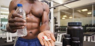 fitness guy with fat burning pills