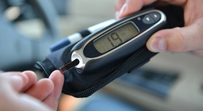 man measuring blood sugar