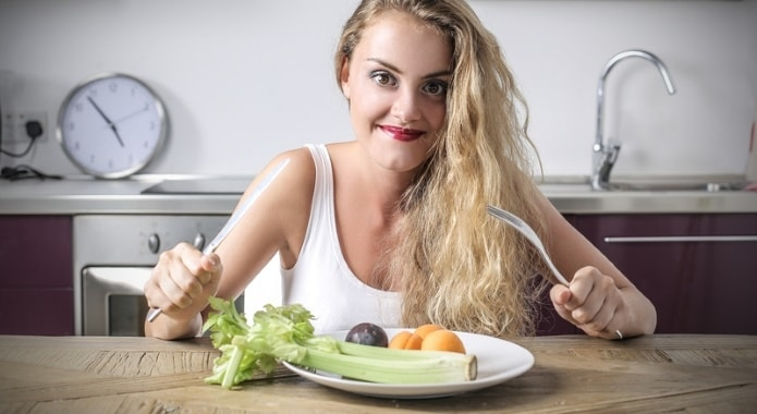 Girl-Eating-Fruits-and-Vegetables-min