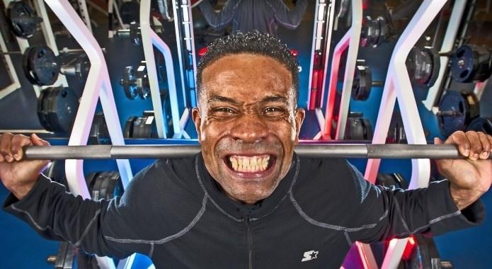 man pushing weights